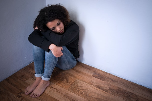 Sad and lonely young girl feeling depressed