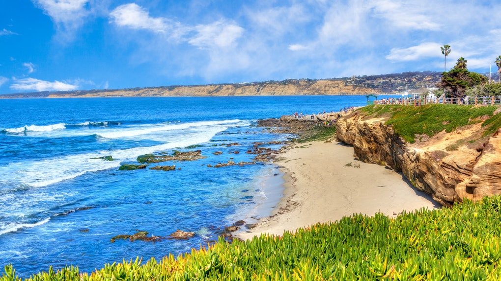 Sunny late afternoon at the popular scenic seaside town of La Jolla Cove beach in San Diego, California.