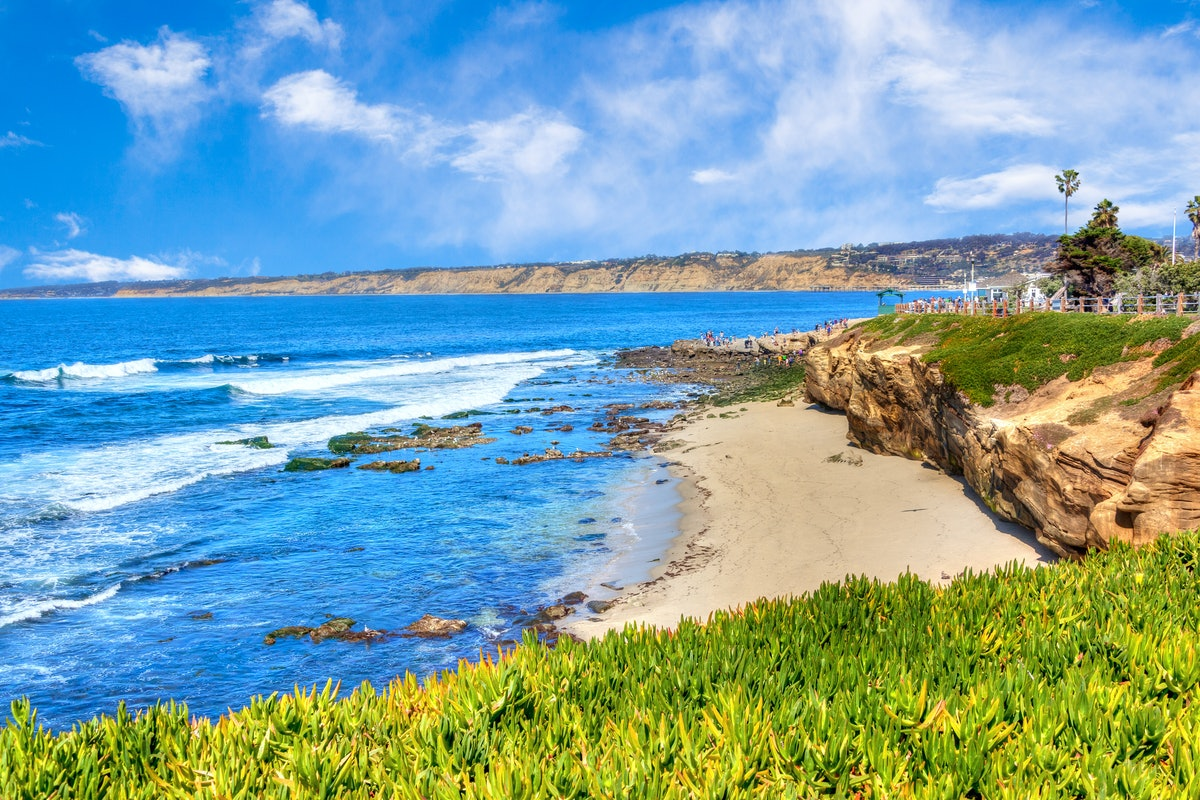 Sunny late afternoon at the popular scenic seaside town of La Jolla Cove beach in San Diego, Califor...