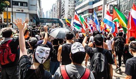 Two protesters with Guy Fawkes masks during the demonstration