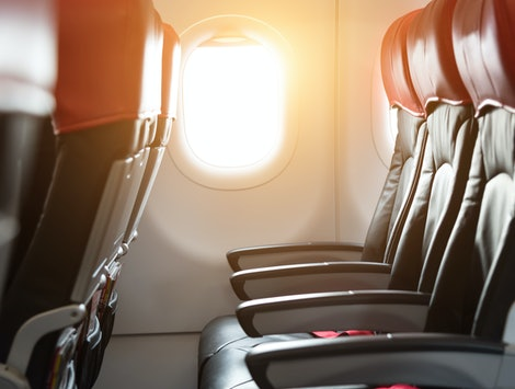 Black and red passenger seat on the airplane.
