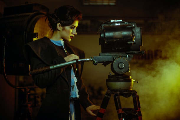 Beautiful female as actress with camera