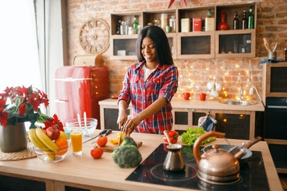Black woman cooking healthy breakfast on kitchen. Personal factors that can influence food choices may include family upbringing, health concerns, and what people can afford to buy, the European Food Information Council (EFIC) says.
