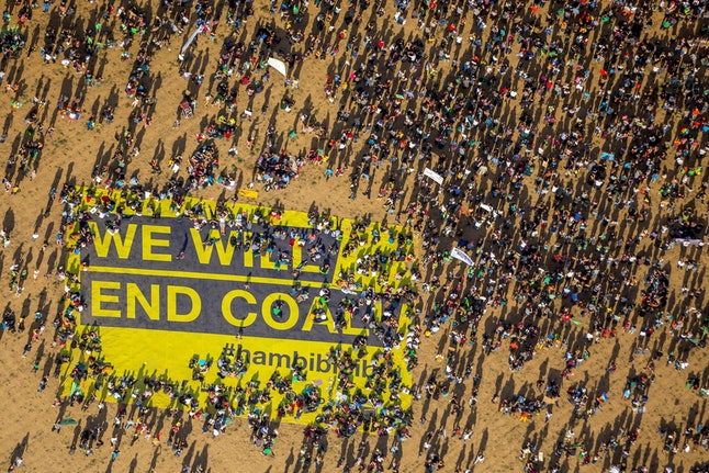 Many people on large-scale demonstration with Banner We will end coal, against the deforestation of Hambach Forest, Hambach Forest, Hambach, Etzweiler, Elsdorf, Braunkohlegebiet, Rhineland, North Rhine-Westphalia, Germany