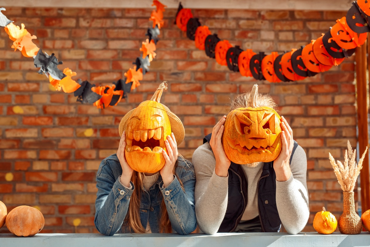 A couple holding carved pumpkins in front of their faces would need pumpkin captions for couples to post with whatever pictures they take.