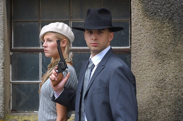 Two models get dressed up in 1930's style vintage fashion clothes and act the role of the gangster d...