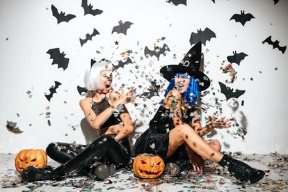 Pumpkin puns for Instagram are great for these two women throwing glitter in the air, dressed up in ...