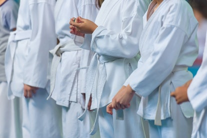 Children in a kimono on tatami. Classes in karate on mats