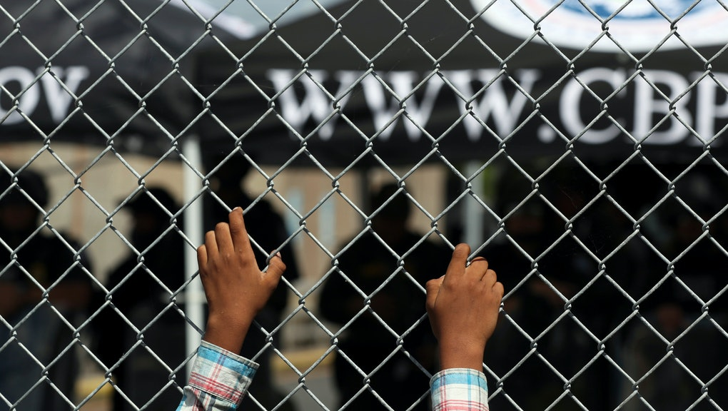 A migrant leans on a fence of the Gateway International Bridge that connects downtown Matamoros, Mexico with Brownsville, . Migrants wanting to request asylum camped out on the international bridge leading from Mexico into Brownsville, Texas, causing a closure of the span