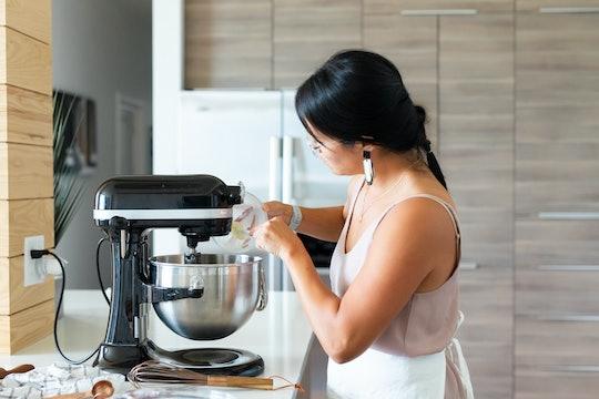 Woman Baking in the Kitchen Using KitchenAid mixer