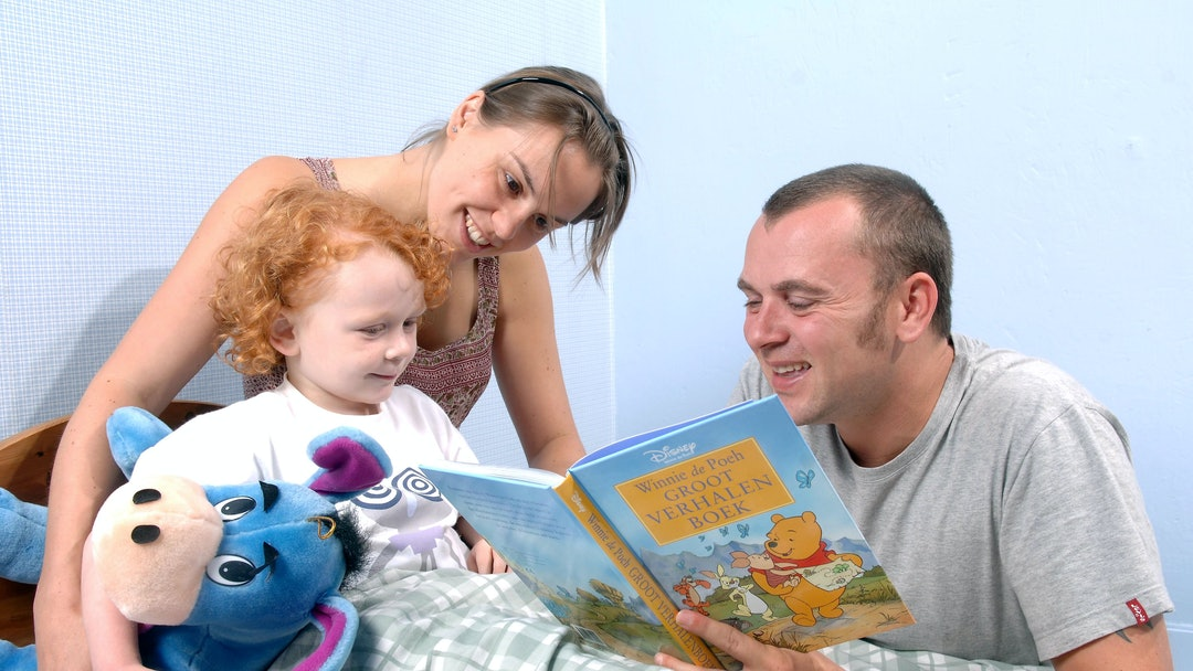 Model released - Parents reading child a bedtime story