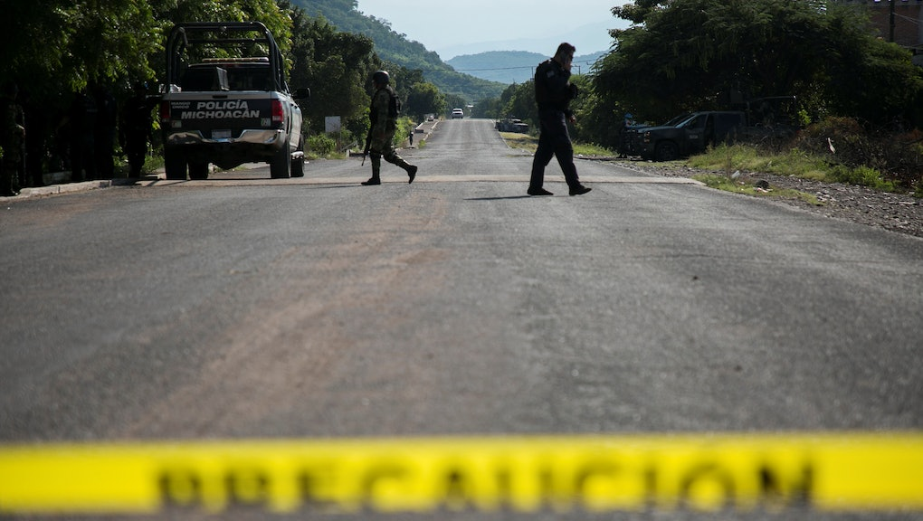 General view of the operation of the Security Forces after the ambush of a police convoy by an armed group, in Aguililla, Michoacan State, Mexico, 14 October 2019. At least 13 state police were murdered by the Jalisco Nueva Generacion Cartel (CJNG) in the municipality of Aguililla, in the state of Michoacan, which led to the start of an official offensive against drug traffickers in this Mexican region.