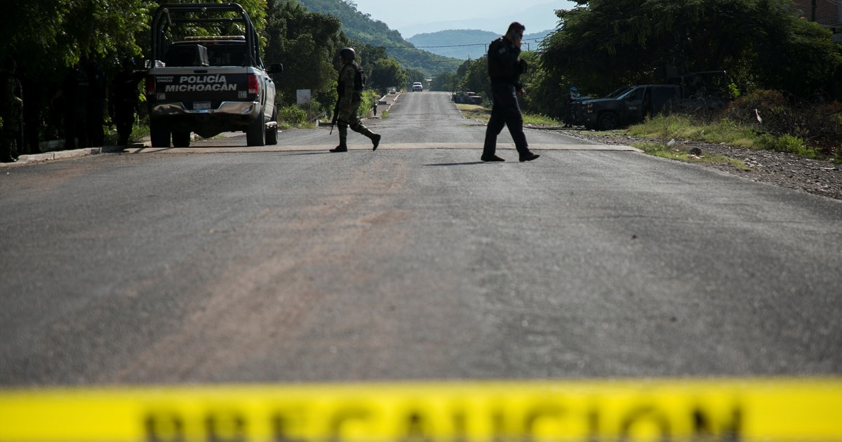 Mexican cartel members ambush police, killing 13 in grisly attack