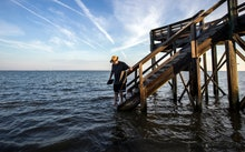 Visiting the area for the first time, 64-year-old Fran Glod of Oswego, N.Y, walks down the steps to ...