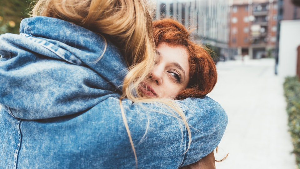 Two young women friends hugging outdoor - friendship, love,