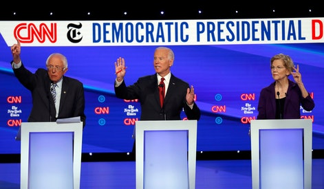 Bernie Sanders, Joe Biden, Elizabeth Warren. Democratic presidential candidate Sen. Bernie Sanders, I-Vt., left, former Vice President Joe Biden, center, and Sen. Elizabeth Warren, D-Mass., raise their hands to speak during a Democratic presidential primary debate hosted by CNN/New York Times at Otterbein University, in Westerville, Ohio