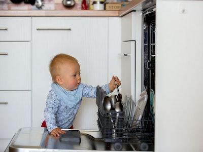 Toddler/Baby boy reaching into a dishwasher
