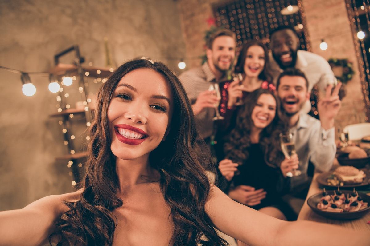 Close up photo of cheerful lovers celebrate xmas christmas party make selfie gather around table wit...
