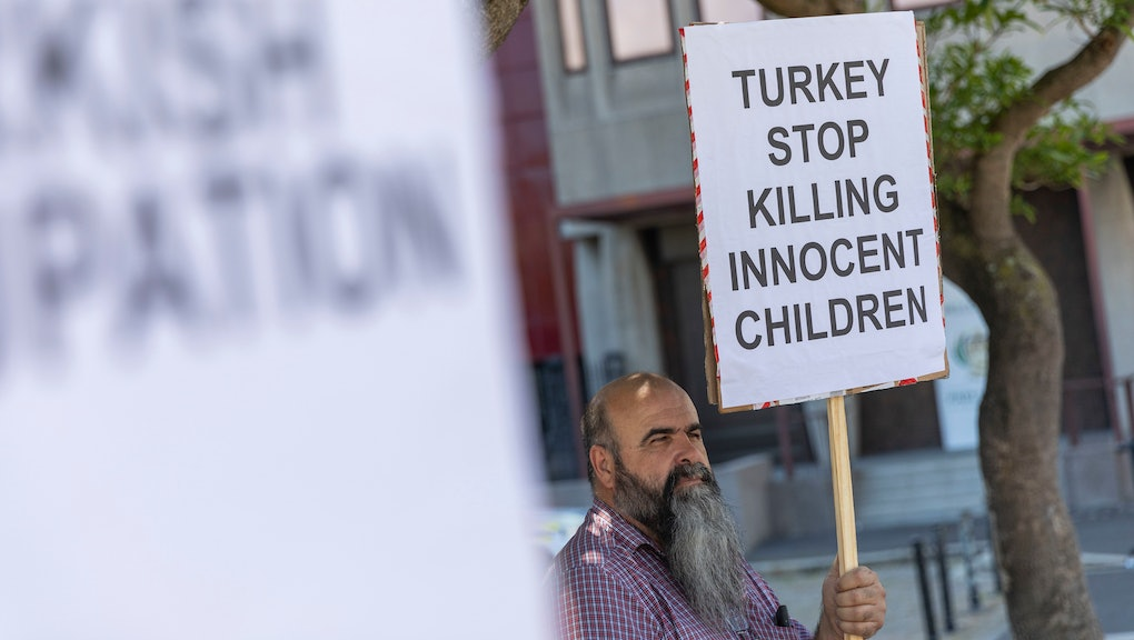 Members of the Kurdish Human Rights Action group protest outside the South African Parliament in Cape Town, South Africa 16 October 2019. The protestors handed over a memorandum to parliament calling on the South African government to put pressure on the Turkish state to stop the human rights abuses and invasion in Rojava, North Eastern Syria. They also called for the government to recognise the self administration in Rojava.