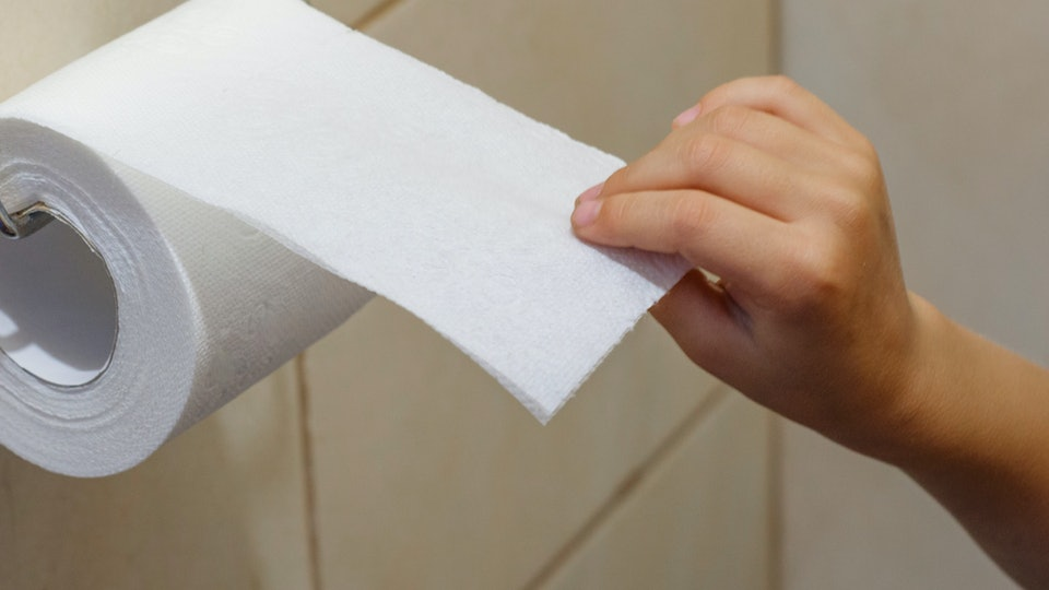 A child tears off toilet paper. Indigestion in children