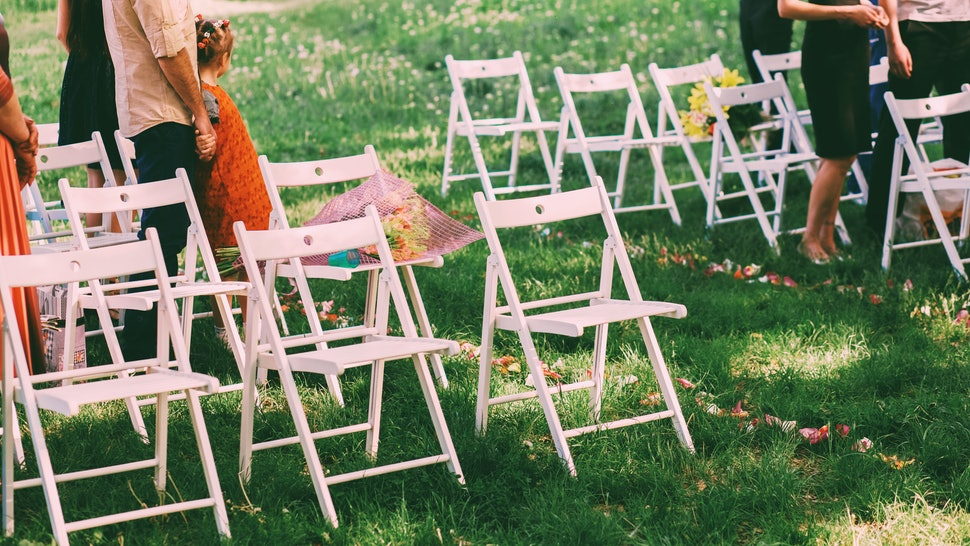 Wedding guests near white chairs on grass. Not drinking at a wedding can be challenging, but there are lots of tips to help you get through.
