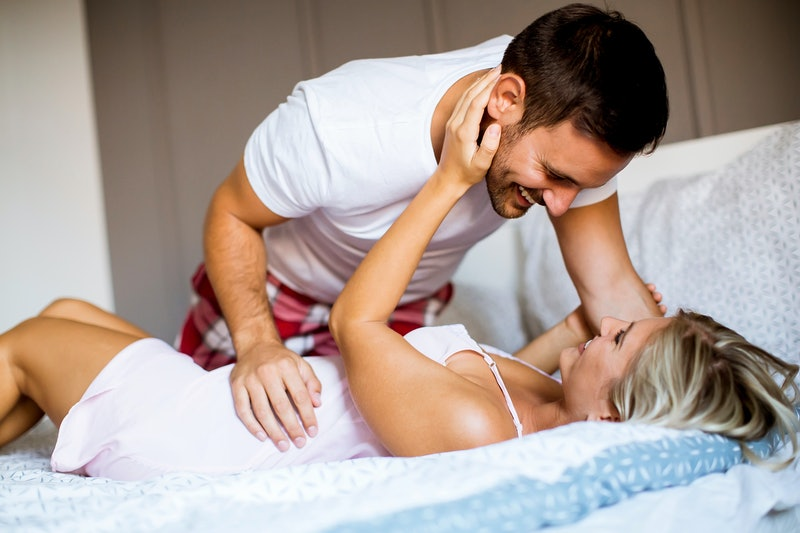 Lovely happy young couple in the bed