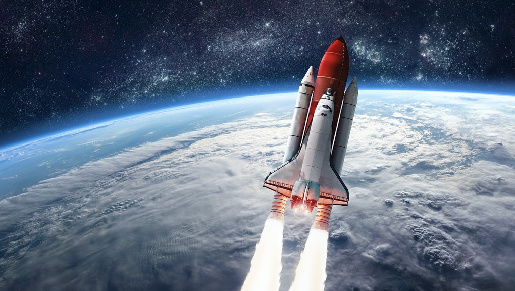 Space shuttle launch in the open space over the Earth. Ocean and sky under space ship. Elements of this image furnished by NASA