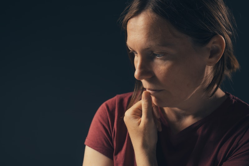 Low key portrait of depressed sad woman