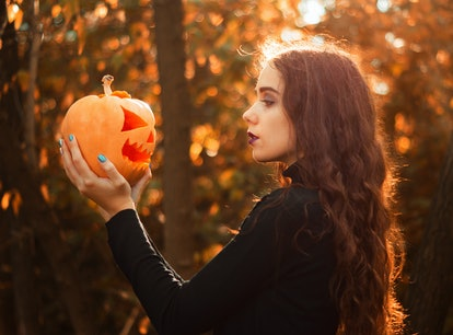 Young autumn fall woman wondering which zodiac signs will be most affected by the October 2021 new m...