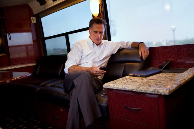 Mitt Romney Republican presidential candidate, former Massachusetts Gov. Mitt Romney check his phone while riding on his bus after a campaign stop in Council Bluffs, Iowa