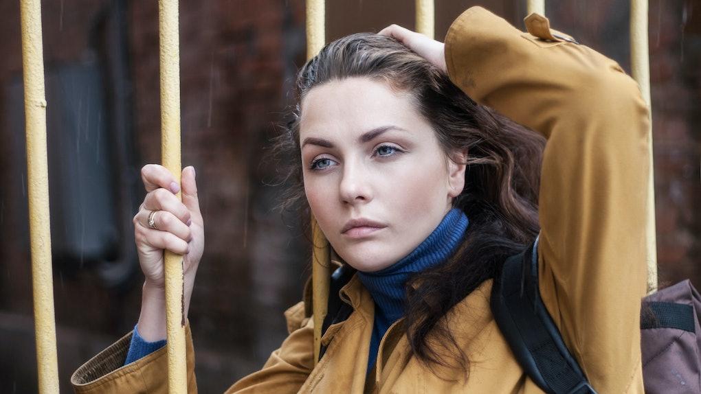 Portrait of a young sad woman outdoors closeup.