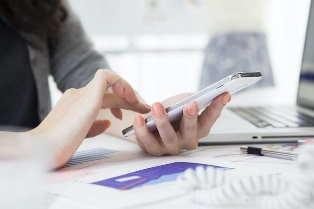 Women manipulating smart phone