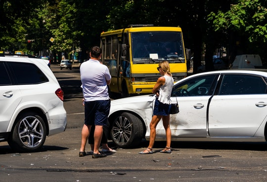 Man and woman talking after traffic accident