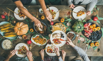 Host your own Friendsgiving, potluck style for ease.