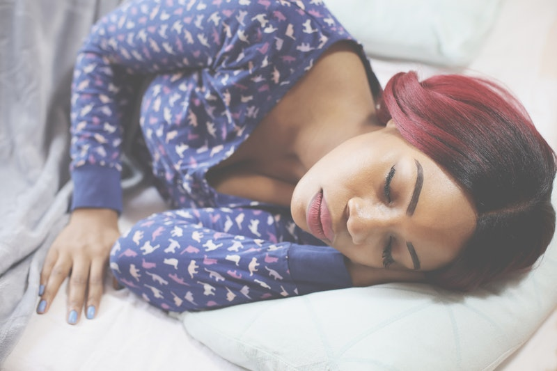 African American woman sleeping in bed. Space for copy.