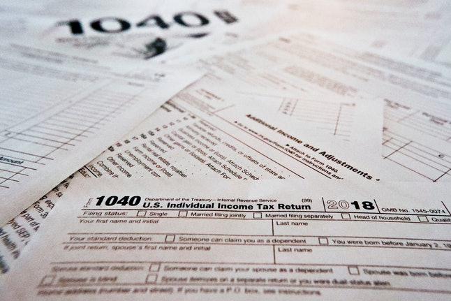 PHOTOS**This photo made, in Zelienople, Pa., shows mulitiple forms printed from the Internal Revenue Service web page that are used for 2018 U.S. federal tax returns