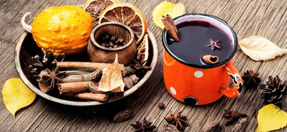 Mulled wine hot drink with citrus and spices
