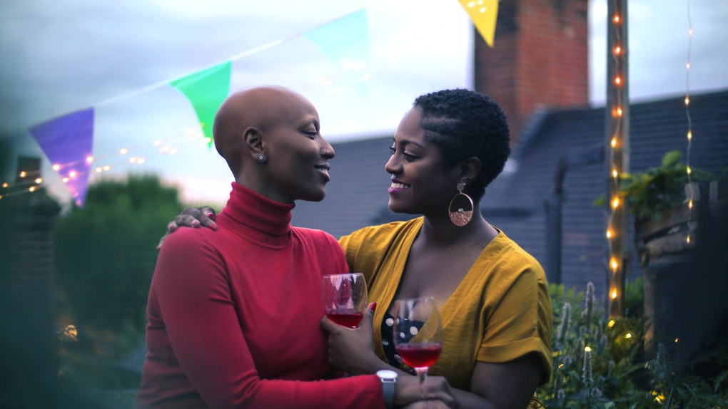 Loving couple celebrating on a terrace