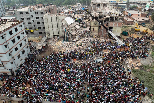 Bangladeshi people gather as rescuers look for survivors and victims at the site of a building that collapsed a day earlier, in Savar, near Dhaka, Bangladesh. A Bangladesh court, indicted 41 people for murder in the 2013 deaths of more than 1,100 people in the collapse of a building that housed five garment factories outside the capital