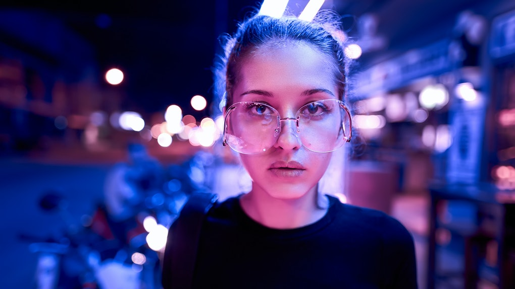 portrait of beautiful woman in neon light. night city street shot
