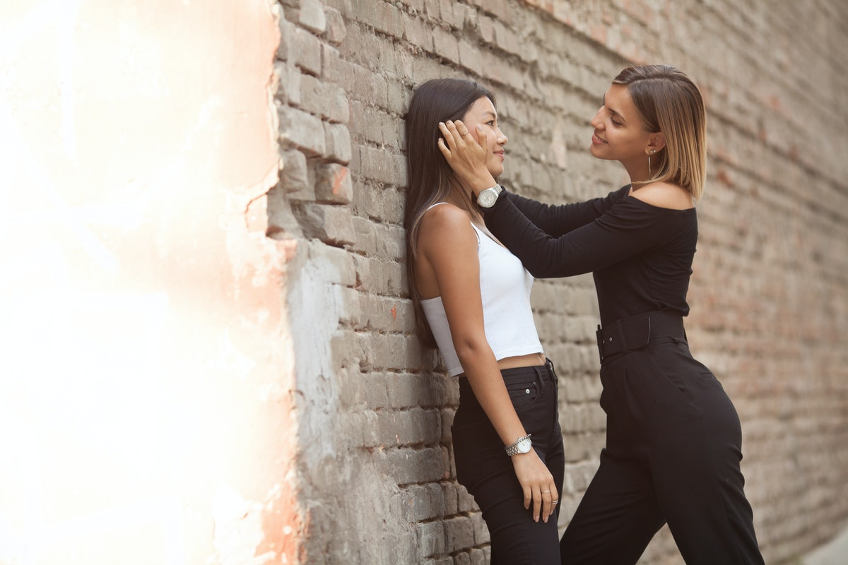 LGBT lesbian women couple moments happiness. Lesbian women couple together outdoors concept. Lesbian couple embraced together relation fall in love. Two asian women having fun together at park.