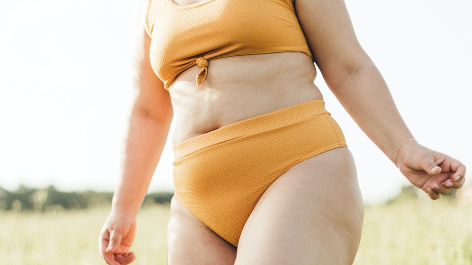 chubby and skinny girls dressed in stylish lingerie loving herself and her body posing for photo in sunny hot day outdoors. loose women in the underwear, cropped photo
