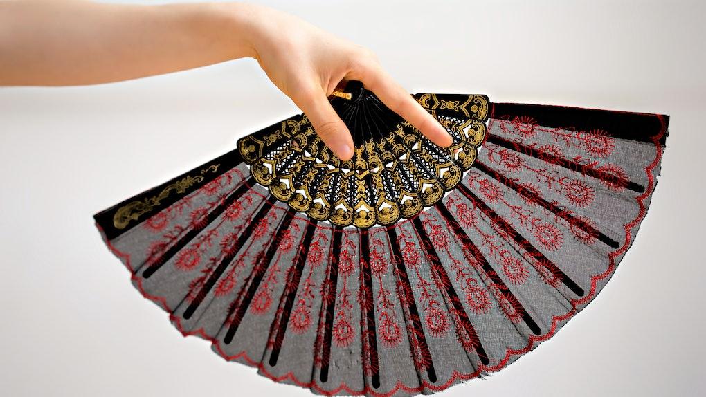 Female hand holding a fan