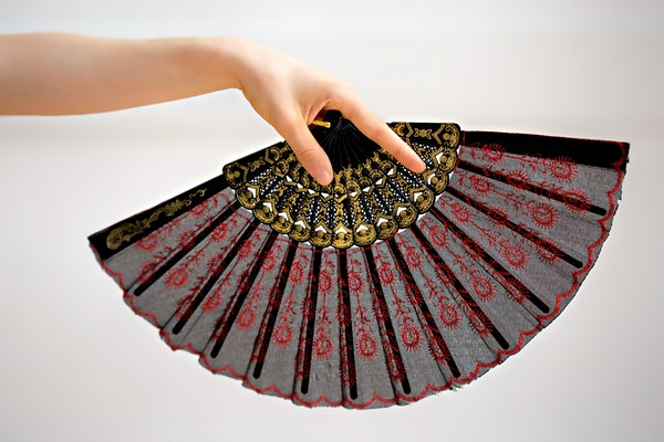 Female hand holding a fan