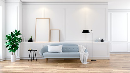 Modern mid Century room interior , Gray  sofa with mock-up on white wall and wood floor ,3d rendering