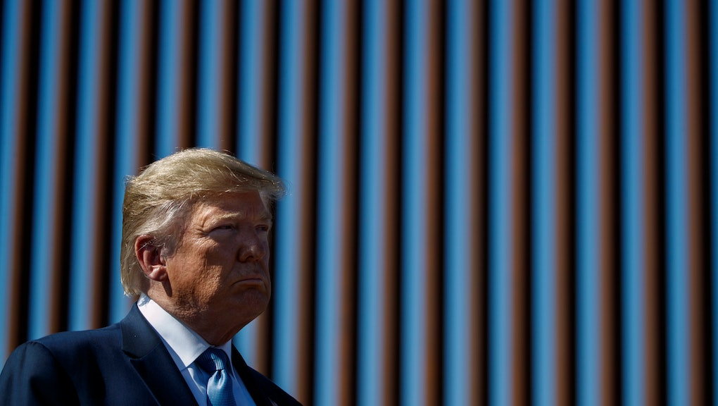 President Donald Trump tours a section of the southern border wall, in Otay Mesa, Calif