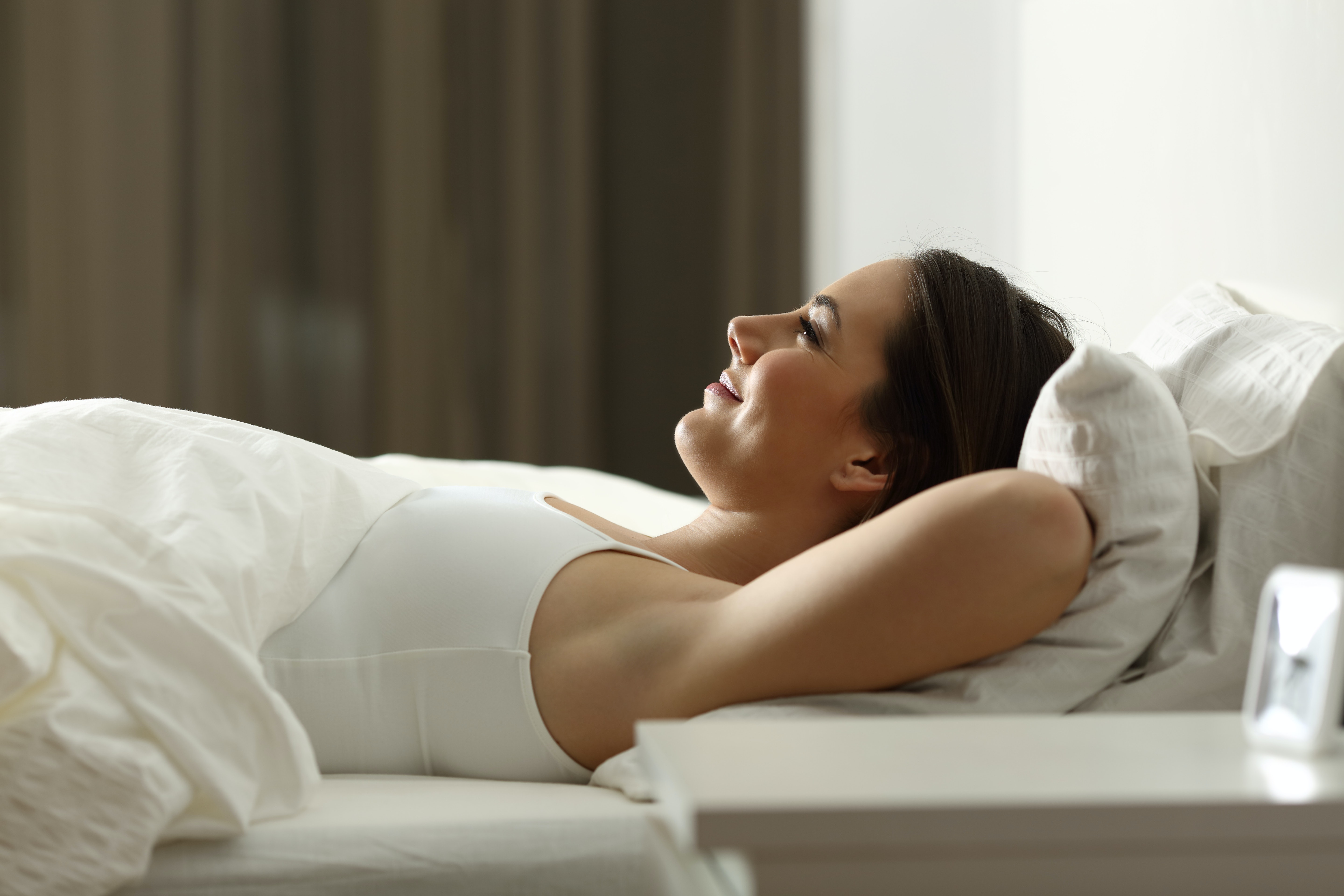 What Does Sleeping With Your Arms Above Your Head Mean Experts Say It Could Mean A Few Things