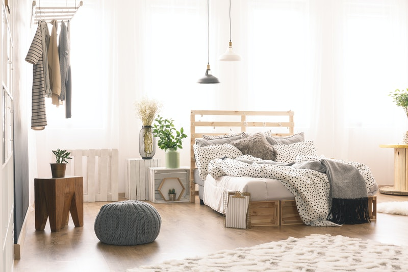Cozy bedroom with modern wooden furniture