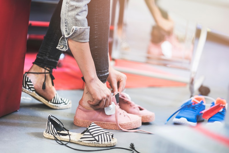 Woman trying shoes in store