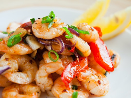 shrimp, peppers and onions on a plate